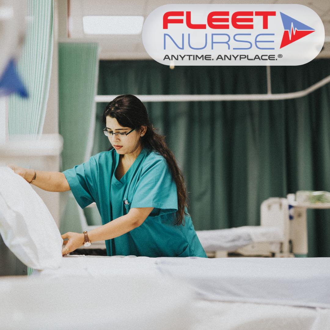 Nurse fixing a bed